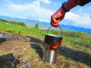 Setting the pot on the Solo Stove to boil water.