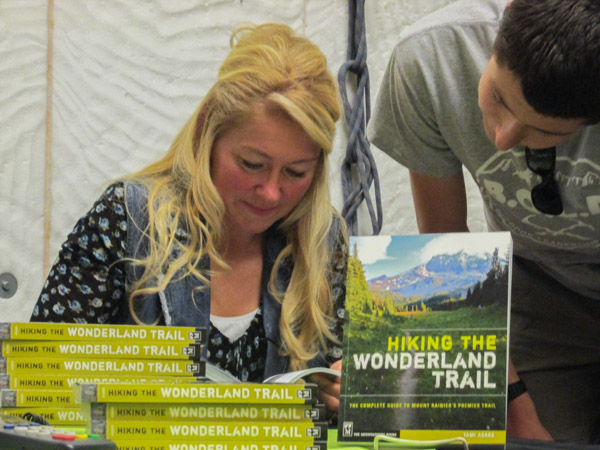Tami Asars signs her latest book for fans at the Seattle Mountaineers.