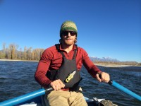 Brooks Cowles guiding a rafting trip down the Snake River wearing the Pint Sunglasses by Ryders Eyewear