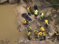 Search and rescue members prepare to extract a body of one of the seven canyoneers killed during a flash flood on Monday.  Source: businessinsider.com