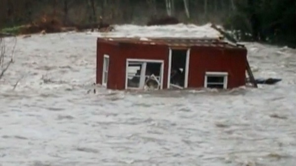 House Falls into Wallace River