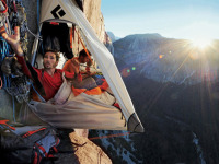 Life on the porta-ledge is cramped, but the view can't be beat.  Climbers Jorgeson (left) and Caldwell rest between pitches. (http://www.epictv.com)